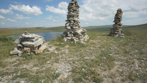 Khakassia. Stone cairns on top of hill (pan up) Stock Video Footage