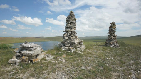 Khakassia. Stone cairns on top of hill (pan up) Footage