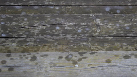 raindrops crashing against the wooden steps Stock Video Footage