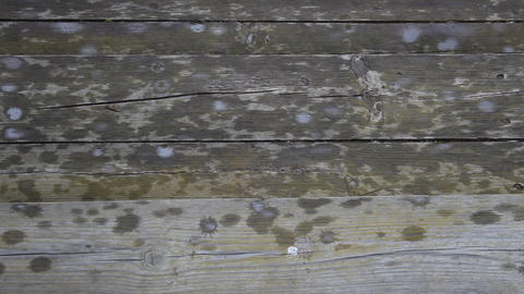 raindrops crashing against the wooden steps Footage