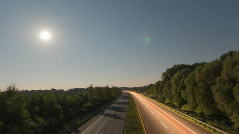 Time lapse highway moon rise zoom pan 11008 Stock Video Footage
