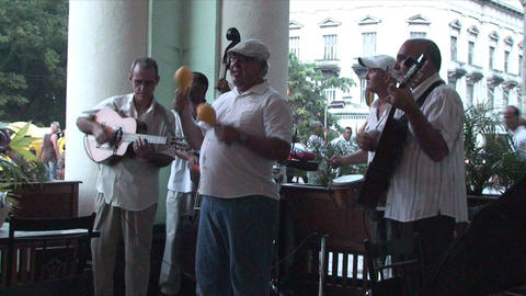 Salsa musicians on terrrace part 6 of 9 Stock Video Footage