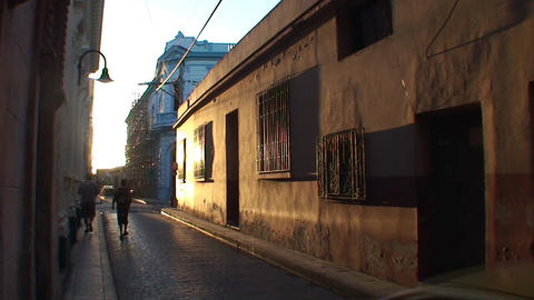 Sunset in street with colonial building Stock Video Footage