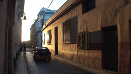 Sunset in street with colonial building Footage