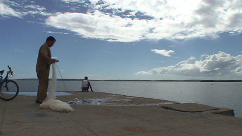 Cienfuegos Harber fisherman pulls out fish net Stock Video Footage