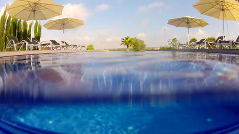 Above and below water view of a swimming pool Footage