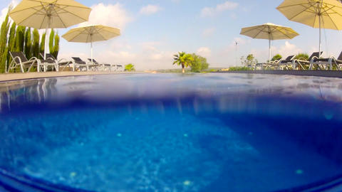 Above and below water view of a swimming pool Stock Video Footage