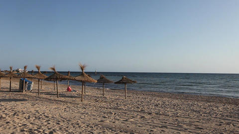 Romantic wide shot of the beach and parasols on Ma Stock Video Footage