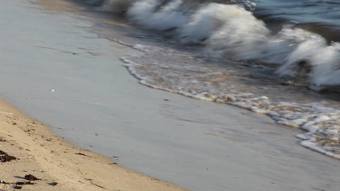 Surf lapping on a sandy beach Stock Video Footage