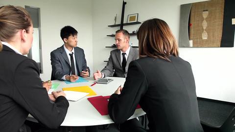 Five international people having a business meetin Footage
