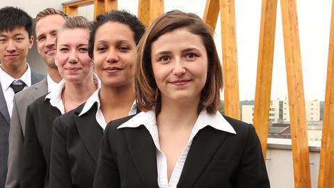 A group of five international businesspeople stand Stock Video Footage