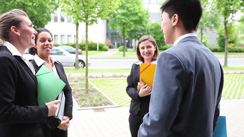 Five international businesspeople meeting in front Stock Video Footage