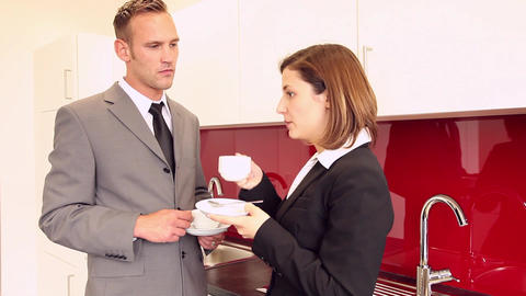 Two businesspeople having a coffee break in pantry Stock Video Footage