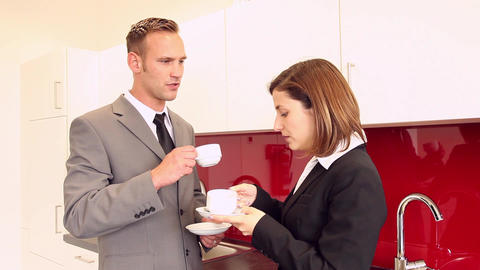 Two businesspeople having a coffee break in pantry Footage
