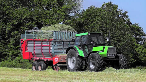 Farmer harvesting grass silage Footage