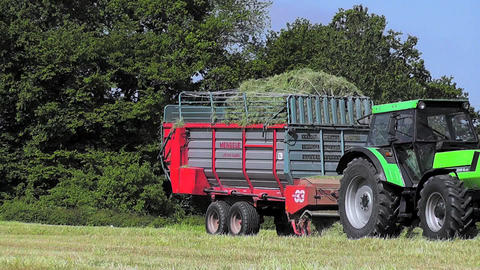 Farmer harvesting grass silage Stock Video Footage