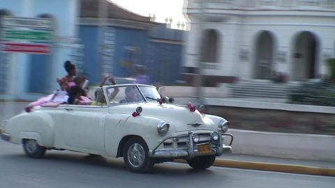 Cuba Sancti Spiritus Sweet sixteen parade in car Stock Video Footage