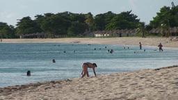 Trinidad Playa Ancón woman looking for shells Stock Video Footage