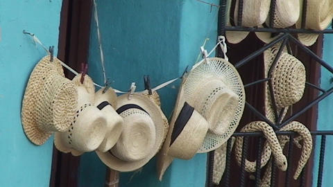 Trinidad Streetview cuban hats on wall Stock Video Footage