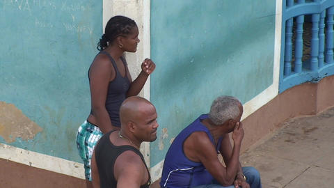 Trinidad Streetview Cuban people relaxing Stock Video Footage