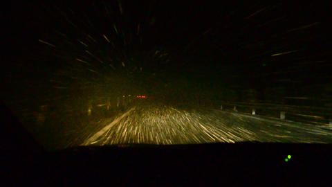 Driving with a car through heavy snow fall in Japa Stock Video Footage
