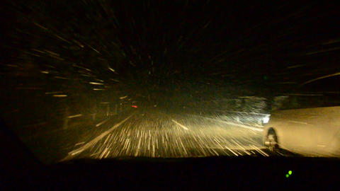 Driving with a car through heavy snow fall in Japa Footage