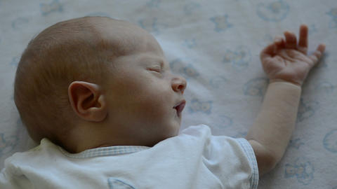 Cute baby sleeping and dreaming, seen from above Stock Video Footage