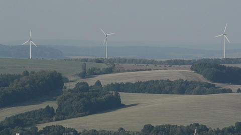 Rotating wind turbines on a field in Germany Stock Video Footage