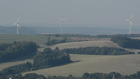 Rotating wind turbines on a field in Germany Footage