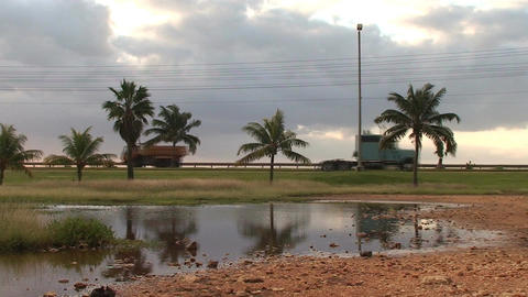 Cuba Street with cars at a pond 2 Stock Video Footage