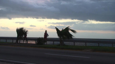 Cuba Sunrise street with bus and runners Stock Video Footage