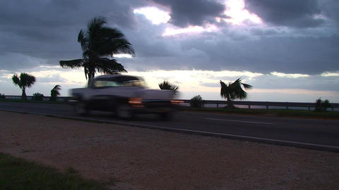 Cuba Sunrise street with cars 2 Stock Video Footage