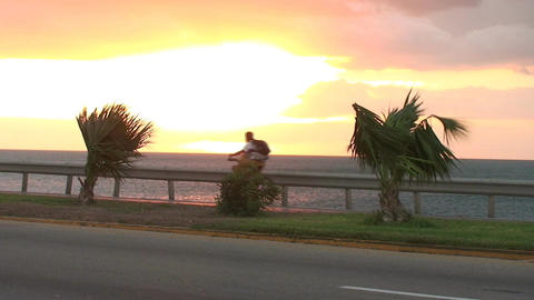 Cuba Sunrise street with cars and bicycle Footage