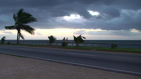 Cuba Sunrise street with cars and runners 2 Footage