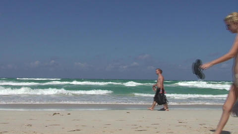 Varadero Girls and boys passing by at seaside Footage