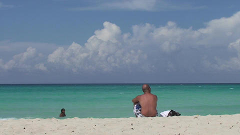 Varadero man alone at the beach blackwomen in sea Stock Video Footage