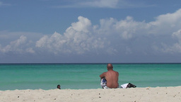 Varadero man alone at the beach blackwomen in sea Stock Video Footage