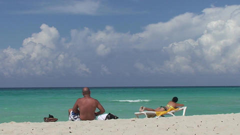 Varadero man and women at the beach women in sea Stock Video Footage