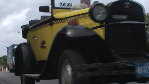 Varadero Old taxi passing by Stock Video Footage