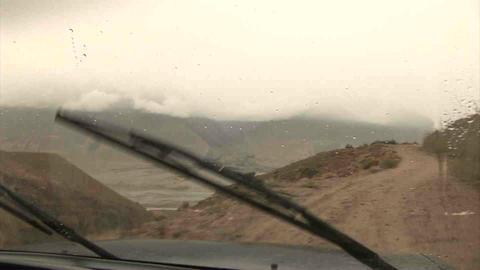 Driving in Wakhan Valley Rain Tajikistan & Afghani Stock Video Footage