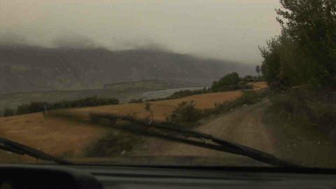 Driving in Wakhan Valley Rain Tajikistan 4 Stock Video Footage