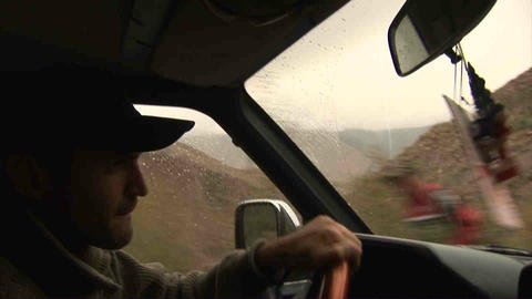 Guy driving in Wakhan Valley Rain Tajikistan 2 Stock Video Footage