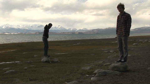 Guys standing View on Karakul Lake Tajikistan Stock Video Footage