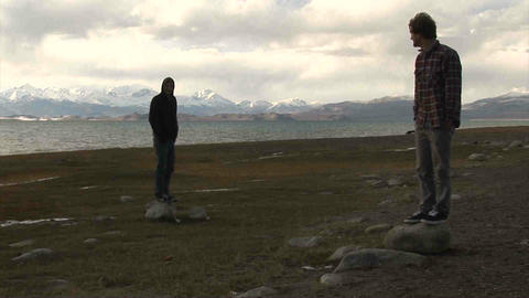 Guys standing View on Karakul Lake Tajikistan Footage