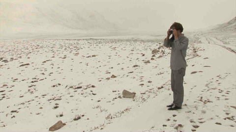 Guy taking picture View Analogue Snow Tajikistan Stock Video Footage