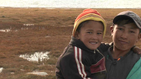 Kids pose for camera Karakul Lake Tajikistan 2 Stock Video Footage