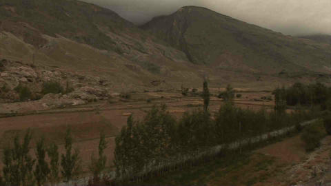 View on Roadside & Mountains Pan Tajikistan & Afgh Stock Video Footage