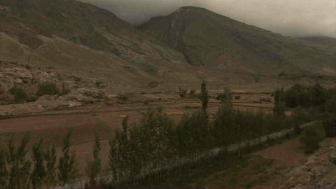 View on Roadside & Mountains Pan Tajikistan & Afgh Stock Video Footage