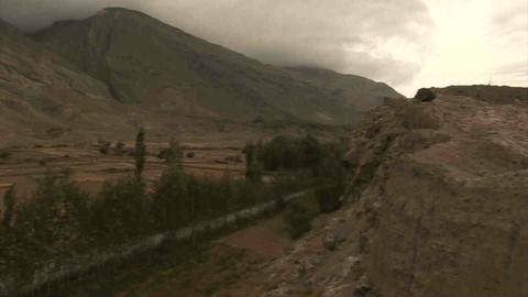 View On Roadside & Mountains Pan Tajikistan & Afgh stock footage