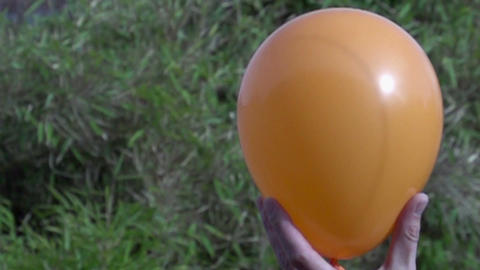 Bursting balloon slowmotion 400fps Stock Video Footage